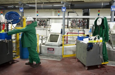 An employee works in the production area at Chemetall in Blackman Township on Monday, Sept. 15, 2014. The company earned Q1 status from the Ford Motor Company. (J. Scott Park | Mlive.com)