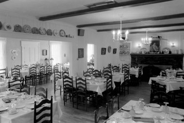 The dining room of Bauer Manor in 1968. The decor featured antiques fitting the building's history as an early stagecoach stop on what now is U.S. 12 in the Irish Hills. (File photo | MLive.com)
