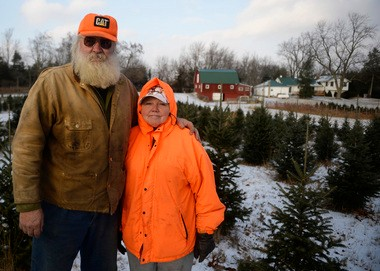 Al and Jennie Bunch stand in their Christmas tree farm called Bunch O Pines Tuesday, December 10, 2013. The Bunches sell their trees for $6 a foot. (Sam Gause | Mlive.com)
