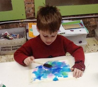 Jack Wheaton, 5, adds to a piece of his artwork at a Jackson School of the Arts class.