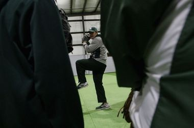 Michigan State baseball coach Mark Van Ameyde coaches pitching during the MSU baseball clinic at Extra Innings in Jackson Monday, January 20, 2014.