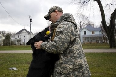 """In this 2012 file photo, Jackson County Sheriff's Deputy Mark Easter rewards his police dog, Brix, after a practice narcotics search. Easter's 3-year-old son, Michael, on March 2 accidentally shot himself with a handgun registered to his father. Easter and his wife, Melissa, are """"devastated"""" by the tragedy, the couple's lawyer, Eric White, said."""