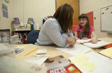 Brooklyn Barnes, 7, a first grader at Vandercook Lake's Townsend Elementary School, works with Reading Recovery teacher Becca Bradley at the school on Wednesday, April 23, 2014. (J. Scott Park | Mlive.com)