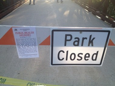 The entrance to the Lions Park in Jackson remains closed while officials clean an oil spill in the Grand River.