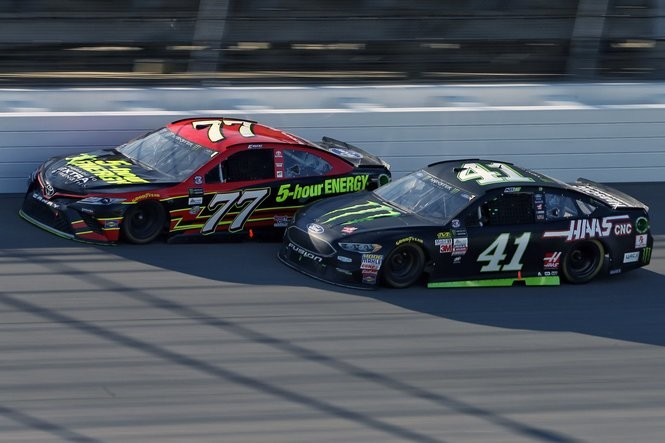 Monster Energy Cup Series drivers Erik Jones (77) and Kurt Busch (41) race near the wall during the Firekeepers 400 NASCAR race at Michigan International Speedway in Brooklyn, on Sunday, June 18, 2017. (Mike Mulholland | MLive.com)