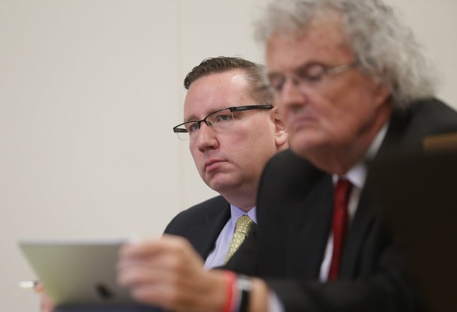 Andrew Frounfelker, left, listens as his former girlfriend testifies about the injuries she allegedly sustained during a preliminary hearing Thursday in front of Jackson County District Court Judge R. Darryl Mazur.
