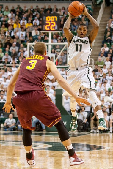 Michigan State's Keith Appling (11) passes to Gary Harris during their game against Minnesota at the Breslin Center in East Lansing, Wednesday, Feb. 6. Michigan State won the game, 61-50.