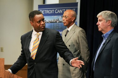(center) Former bankruptcy lawyer, Kevyn Orr, was appointed as the City of Detroit's Emergency Financial Manager at a press conference Thursday with Michigan Governor Rick Snyder and Detroit Mayor Dave Bing, March 14. (Tanya Moutzalias | MLive.com)