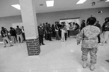 "New Mumford High School, Principle Kenyetta ""K.C.""Wilbourn, checks with security during students' lunch hour in the cafeteria on her patrol Wednesday afternoon, April 15. (Tanya Moutzalias 