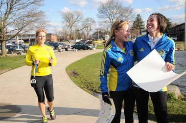 (left) Nancy Smith, from Shelby Township, and Stephanie Schreiber-Bland, from Oxford, hug after crossing the finish line of their Boston Marathon at Rochester Municipal Park Thursday, April 24. (Tanya Moutzalias | MLive.com)