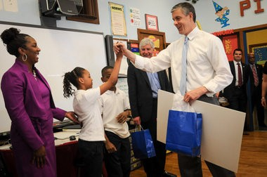 Michigan Gov. Rick Snyder and (right) U.S. Secretary of Education Arne Duncan visited a fifth-grade and pre-kindergarden Detroit Public School classroom at Thirkell Elementary Monday morning, May 6. Gov. Snyder and Secretary Duncan listen to Miss Pitt's fifth grade classroom given presentation on the U.S. states. They also read the book, The Rainbow Fish, to a pre-kindergarden classroom. (Tanya Moutzalias   MLive.com)