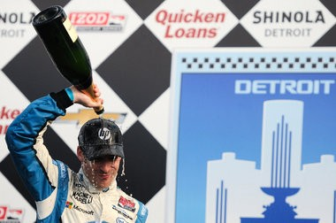 Simon Pagenaud, of the #77 Schmidt Hamilton HP Motorsport Honda IndyCar, pours champagne over his head after winning the second race of the Chevrolet Indy Dual in Detroit presented by Quicken Loans at the Chevrolet Detroit Belle Isle Grand Prix Sunday, June 2. (Tanya Moutzalias | MLive.com)