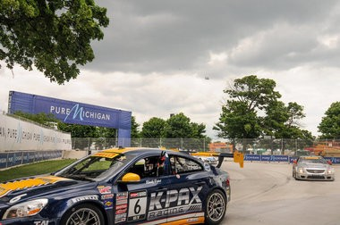 Ryan Pobst, in the #6 K-PAX Volvo S60, makes a peace sign at the Pure Michigan corner in his victory lap with second place winner Johnny O Connell close behind him in the #3 Cadillac CTS-VR for Cadillac racing. Pobst came in first the GT in the Pirelli World Challenge round 7 at the Chevrolet Detroit Belle Isle Grand Prix Sunday, June 2. (Tanya Moutzalias | MLive.com)