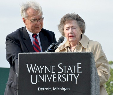 """Ernie Harwell's wife, Lula (aka """"Lulu"""") speaks briefly at the unveiling of the new Harwell Field construction plans at Wayne State University alongside family friend Gary Spicer. The university has announced plans for the $500,000 field to start construction in spring of 2014."""