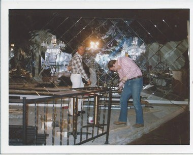 Tom Schoenith (left) works on the Palm River Club in an undated photo (courtesy image).