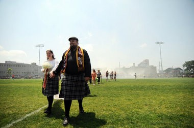 Alex Spawr, 31, of Clawson and Katie Forzley, 28, of Troy, tied the knot during half time of Detroit City FC's game against Buffalo FC at Cass Technical High School in Detroit Sunday afternoon, June 23. Along with their family, maid of honor and best man, 1,895 attendees and soccer hooligans cheered on the couple who wed at the half line. The couple, who met 14 years ago, has attended every DCFC match except one in the club's two seasons. (Tanya Moutzalias | MLive.com)
