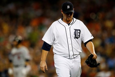 Detroit Tigers relief pitcher Phil Coke walks to the dugout after being pulled after just five pitches during the Tigers' 6-3 loss against the Minnesota Twins at Comerica Park in Detroit on Tuesday, August 20. Coke was later optioned to Toledo to work on his control. (Mike Mulholland | MLive.com)