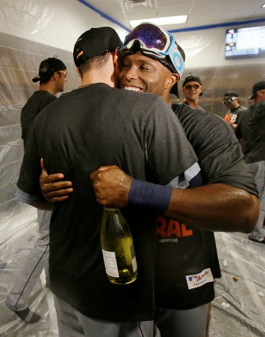 Detroit Tigers' Torii Hunter, right, and a teammate hug as players celebrate after the Tigers clinched the AL Central title with a 1-0 win over the Minnesota Twins in Minneapolis.