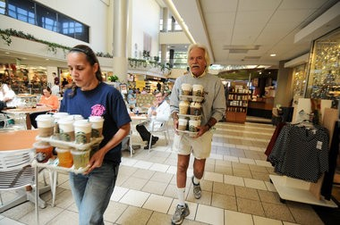 Dan and Valerie balance over 2 dozen Starbucks coffee orders as he heads back to the Rose Cancer Center in Beaumont's Royal Oak campus, Oct. 2. (Tanya Moutzalias | MLive.com)