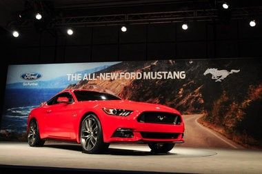 The 2015 Ford Mustang was unveiled Thursday by Ford Motor Co. Chief Operating Officer Mark Fields at the Ford Conference and Event Center in Dearborn, MI, Dec. 5. The iconic Mustang will be revealed today in six cities on four continents. The 2015 design features a sleeker design with a lower, wider stance and bolder dual grille. (Tanya Moutzalias | MLive.com)