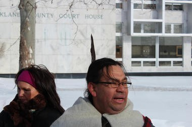 Nearly 30 activists from various Native American organizations and the National Action Network protested in the bitter cold outside the Oakland County Courthouse Monday demanding an apology from Executive L. Brooks Patterson for statements he made to New Yorker magazine comparing Detroit to a reservation.