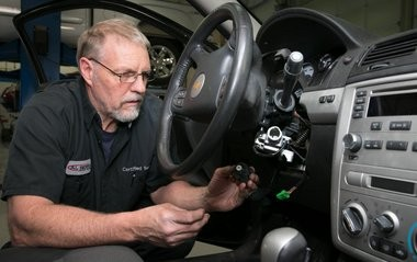 Gary Pittam performs recall service on a Chevrolet Cobalt Thursday, April 17, 2014, at Al Serra Chevrolet in Grand Blanc, Mich. (Photo by John F. Martin for General Motors)