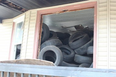 (Gus Burns | MLive Detroit) A look at progress made in disposal of thousands of tires that fill yards and abandoned homes in a northeast Detroit neighborhood. Weeks or even months worth of work still remain to remove them all. (May 7, 2014)