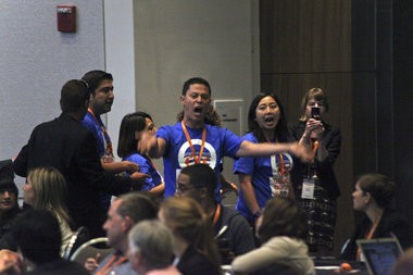 "A group of about five activists wearing T-shirts indicating they were members of the Washington-based immigrants' rights organization United We Dream were escorted out of the Cobo Center in Detroit during a speech by Vice President Joe Biden on Thursday, July 17, 2014. The demonstrators who stood up and persistently chanted ""Stop deporting our families,"" interrupting Biden, who said the group of young activists should be applauded."