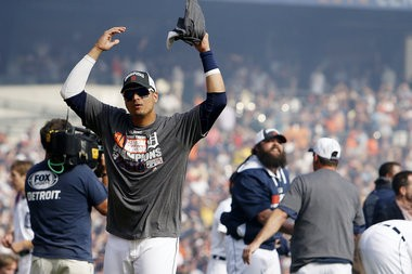 Detroit Tigers designated hitter Victor Martinez celebrates with fans Sunday afternoon after the Tigers clinched the American League Central Division with a 3-0 win over the Minnesota Twins.