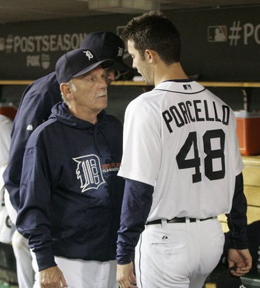Detroit Tigers manager Jim Leyland talks with starting pitcher Rick Porcello (48) in the dugout during the seventh inning of Game 4 of baseball's American League division series against the New York Yankees on Tuesday, Oct. 4, 2011, in Detroit.