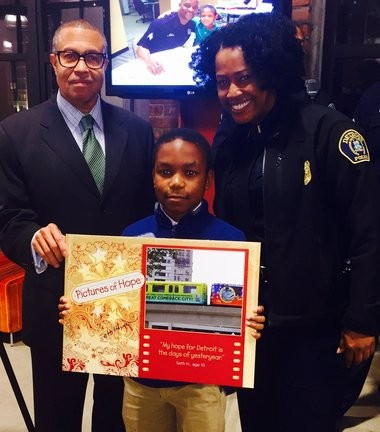 "Detroit Police officers along with Chief James Craig and area kids unveil their ""Pictures of Hope"" on November 10, 2015. (Photo: Linda Solomon Photojournalist / Author)"