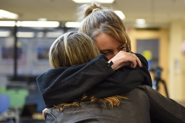 """Henry embraces her friend Kali Williams, 20 of New Boston, who was in the accident three years ago with her. Williams lost her brother in the accident. """"This is for him, today,"""" said Henry. (Tanya Moutzalias 