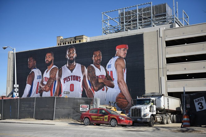 Crews attach large banners featuring the Detroit Pistons to the Little Caesars Arena before a press conference Tuesday held by Detroit Pistons owner Tom Gores and Ilitch Holdings CEO Chris Ilitch, Nov. 22, 2016. An announcement is expected that the Pistons will return to Detroit and join the Detroit Red Wings to play at the under-construction Little Caesars Arena. The Pistons played in the city from 1957 to 1978 before moving into the Pontiac Silverdome and later the Palace of Auburn Hills. (Tanya Moutzalias | MLive Detroit)