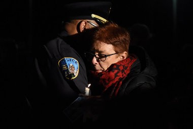 The Wayne State University community, family and friends gathered in the middle of the Detroit campus Tuesday evening to remember the life of Wayne State University Police Officer Collin Rose, Nov. 29, 2016. During the candle light vigil at 6:31 p.m., the time Rose was shot on duty last week, a moment of silence was held. Rose, 29, died last Wednesday, one day after he was shot in the head near Lincoln and Brainard a few blocks from the Wayne State University campus in Midtown Detroit after stopping a man on a bicycle. A 31-year-old man has been charged with first-degree murder in the shooting death of Rose. (Tanya Moutzalias | MLive Detroit)