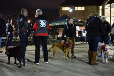 Comfort dogs were present as the Wayne State University community, family and friends gathered in the middle of the Detroit campus Tuesday evening to remember the life of Wayne State University Police Officer Collin Rose, Nov. 29, 2016. During the candle light vigil at 6:31 p.m., the time Rose was shot on duty last week, a moment of silence was held. Rose, 29, died last Wednesday, one day after he was shot in the head near Lincoln and Brainard a few blocks from the Wayne State University campus in Midtown Detroit after stopping a man on a bicycle. A 31-year-old man has been charged with first-degree murder in the shooting death of Rose. (Tanya Moutzalias | MLive Detroit)