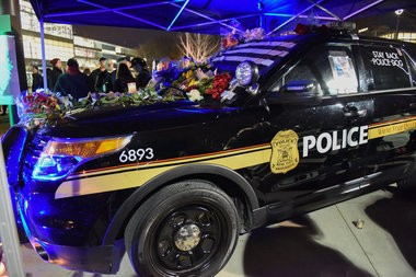 Fallen Wayne State University police officer Collin Rose's police SUV is covered in flowers on WSU's campus. The Wayne State University community, family and friends gathered in the middle of the Detroit campus Tuesday evening to remember the life of Wayne State University Police Officer Collin Rose, Nov. 29, 2016. During the candle light vigil at 6:31 p.m., the time Rose was shot on duty last week, a moment of silence was held. Rose, 29, died last Wednesday, one day after he was shot in the head near Lincoln and Brainard a few blocks from the Wayne State University campus in Midtown Detroit after stopping a man on a bicycle. A 31-year-old man has been charged with first-degree murder in the shooting death of Rose. (Tanya Moutzalias | MLive Detroit)
