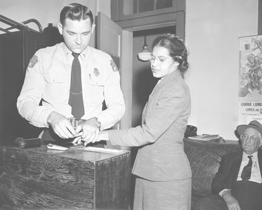 Rosa Parks, whose refusal to move to the back of a bus, touched off the Montgomery bus boycott and the beginning of the civil rights movement, is fingerprinted by police Lt. D.H. Lackey in Montgomery, Ala., Feb. 22, 1956. She was among some 100 people charged with violating segregation laws. (AP Photo/Gene Herrick)