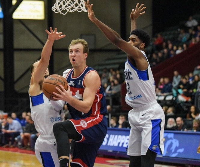 Luke Kennard drives to the basketball during's Friday's game with the Grand Rapids Drive.