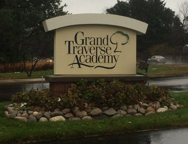 The Grand Traverse Academy in Traverse City faces a budget deficit after writing off money owed it by founder Steven Ingersoll