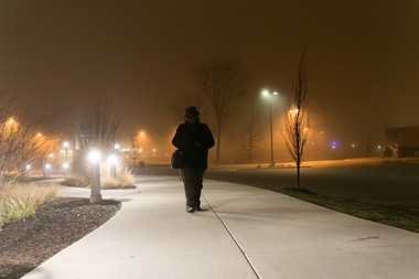 "Williams walks alone on campus on a recent December night. ""My worry isn't where I'm going to be at night,"" he said. ""My worry is how am I going to complete what I need to do?"""