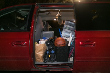 Williams uses his Dodge Caravan as a rolling closet and, in warmer weather, a bedroom. (Bridge photo by Brian Widdis)