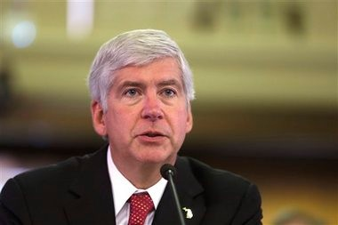 Michigan Gov. Rick Snyder presents his third state budget before the state Legislature in Lansing, Mich., Thursday, Feb. 7, 2013.