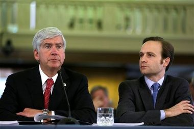 Michigan Gov. Rick Snyder, left, and Lt. Gov. Brian Calley appear before the state Legislature in Lansing, Mich., Thursday, Feb. 7, 2013 to propose the state's budget.