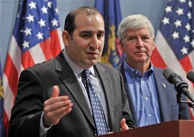 Macomb County Judge David Viviano, left, speaks at a news conference after Gov. Rick Snyder, right, announced him as his choice to fill the open spot on the Michigan Supreme Court bench vacated by Justice Hathaway