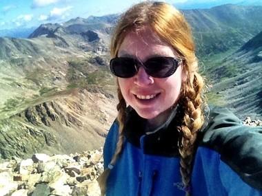 Demas at the top of Mt. Democrat, 14,148 feet, in Colorado in 2012/ Susan J. Demas