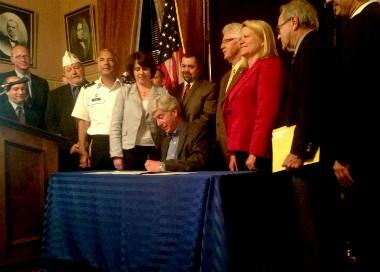 Michigan Gov. Rick Snyder signs legislation on May 14, 2013.