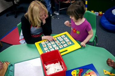 Preschool student Josie Blackman, right, plays a learning game with her teacher Mrs. Jeanne McCutchen at Northeast Elementary School in this file photo.