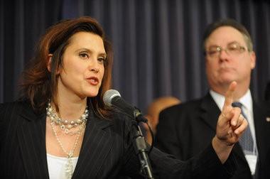 Senate Minority Leader Gretchen Whitmer, left, speaks in this 2011 file photo.