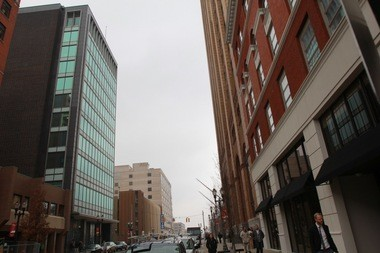 The Farnum Building, left, as seen opposite the Boji Tower on Allegan Street in downtown Lansing, is home to the Michigan Senate.