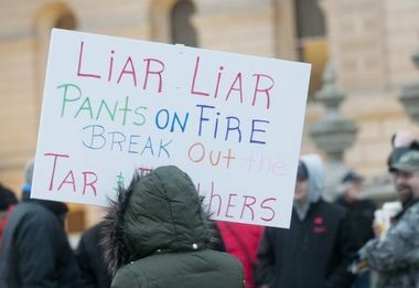 Michigan right-to-work protest signs. View the full gallery >>